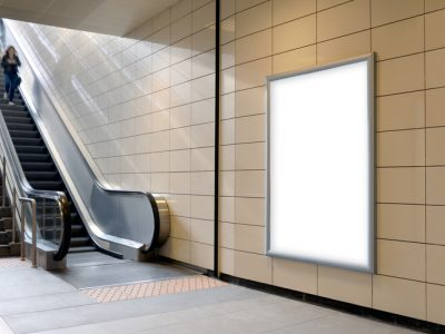 Vertical light box poster mockup in metro station.